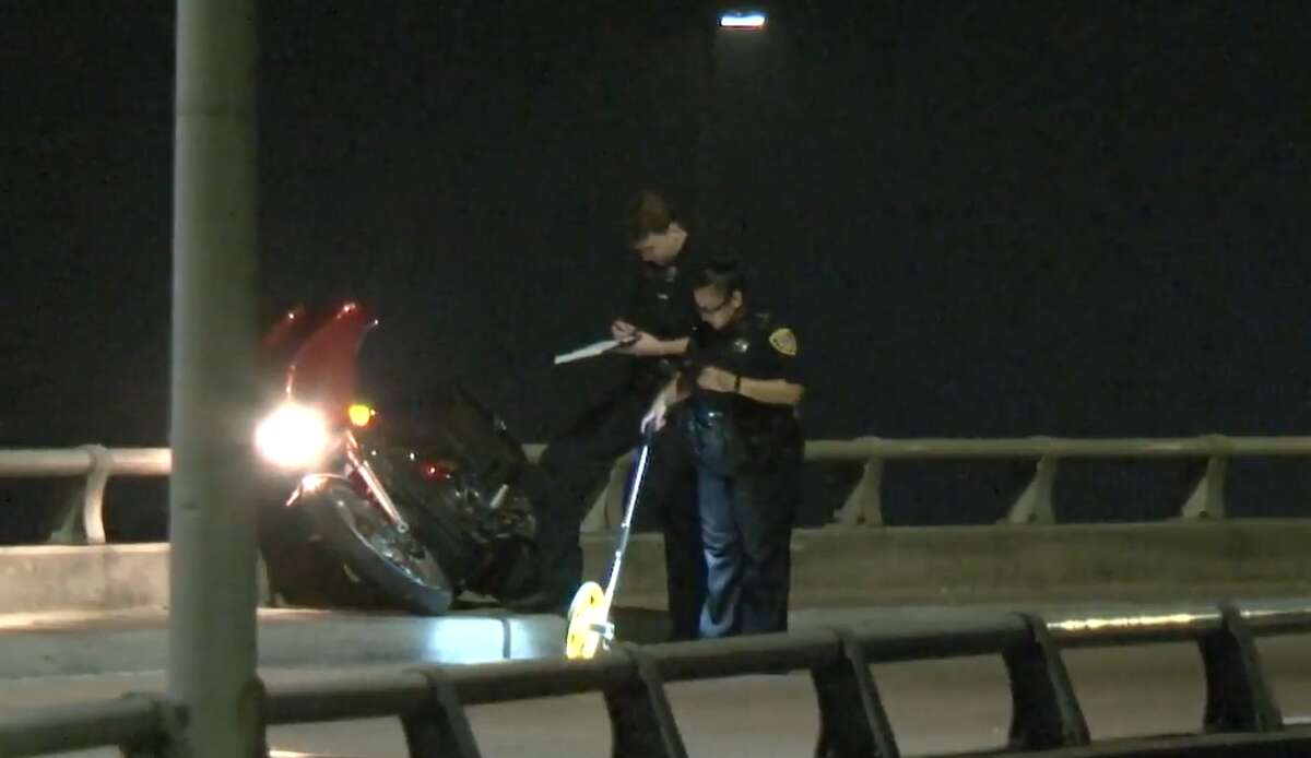 Houston police investigate a fatal motorcycle crash on Will Clayton Parkway near JFK on Sunday, May 26, 2019.