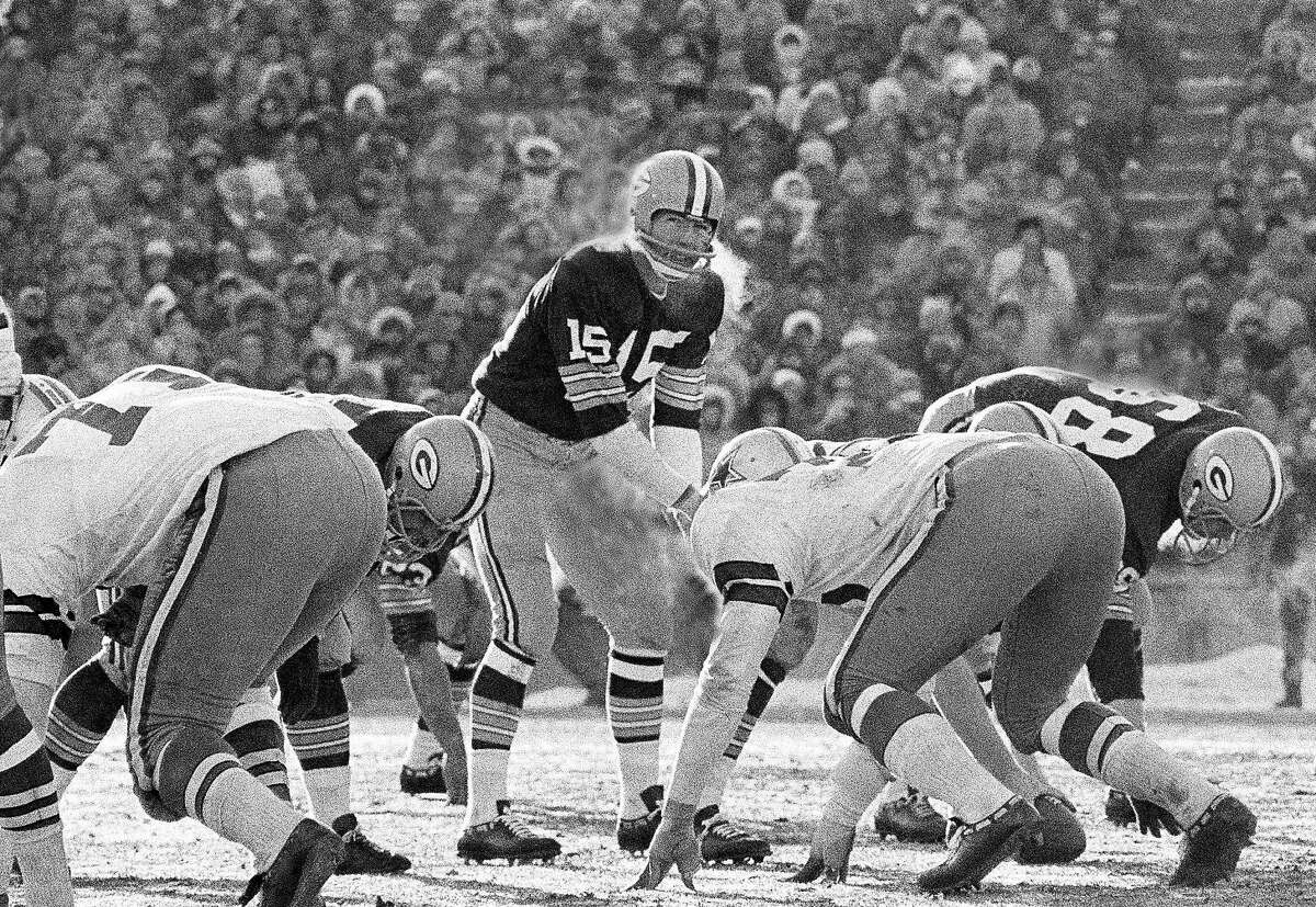 In this Dec. 31, 1967, file photo, Green Bay Packers quarterback Bart Starr calls signals in bitter cold as he led the Packers to a 21-14 win over the Dallas Cowboys to capture third consecutive National Football League title in Green Bay, Wisc. In the history of NFL games, none stands out for the brutal conditions in which it was played like the NFC championship on the last day of 1967. Simply dubbed the Ice Bowl, those who participated in Cowboys-Packers that day at Lambeau Field still shiver when talking about it. (AP Photo/File)