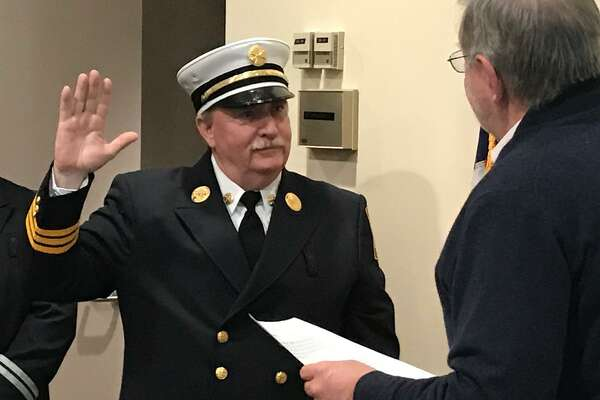 """Chief Fire Marshal Walter """"Bud"""" Seely being sworn in to his new post by Mayor David Martin on Friday, Dec. 21, 2018."""