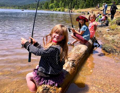 Happy youngsters taking part in Kid's Fishing Day at Lake Siskiyou over Memorial Day Weekend