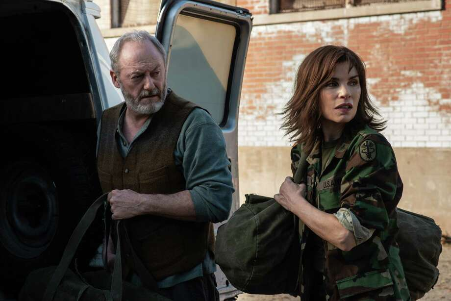 "Dr. Nancy Jaax (Julianna Margulies) and Wade Carter (Liam Cunningham) prepare to enter the Reston Monkey Facility in ""The Hot Zone."" Photo: Amanda Matlovich, National Geographic / National Geographic"