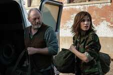 """Dr. Nancy Jaax (Julianna Margulies) and Wade Carter (Liam Cunningham) prepare to enter the Reston Monkey Facility in """"The Hot Zone."""""""