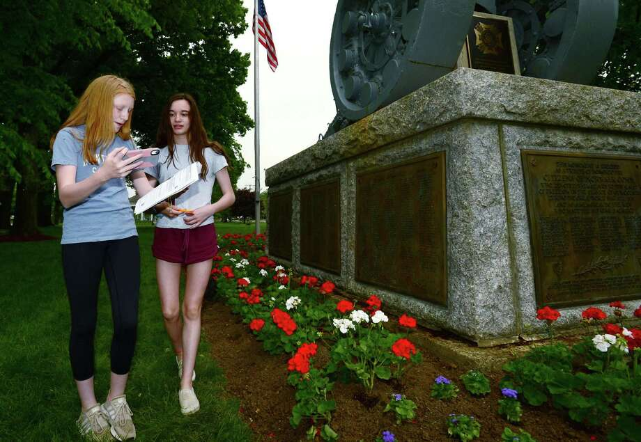 Roton Middle School students in Mark Jackson's 7th grade class, Prudie Phillips and Avery McGurren, vlog their report on the World War l monument at the Norwalk Town Green Thursday, May 23, 2019, in Norwalk Conn. The 7th graders have engaged in a several week long project, visiting Norwalk monuments to veterans and learning about the wars in which those veterans served. Photo: Erik Trautmann / Hearst Connecticut Media / Norwalk Hour