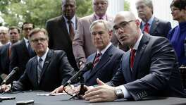 From left, Lt. Gov. Dan Patrick and Gov. Greg Abbott listen as Speaker of the House Dennis Bonnen answers a question during a joint news conference to discuss teacher pay and school finance at the Texas Governor's Mansion May 23. The Legislature did improve teacher pay but problems still remain with school finance generally.
