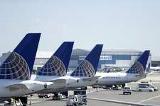 FILE - In this July 18, 2018, file photo, United Airlines commercial jets sit at a gate at Terminal C of Newark Liberty International Airport in Newark, N.J. United Airlines is canceling another month's worth of flights with Boeing 737 Max planes that were grounded after two deadly accidents. United said Friday, May 24, 2019, it has removed the Max from its schedule through Aug. 3 and will cancel about 2,400 flights in June and July as a result. It had previously canceled all Max flights through early July. (AP Photo/Julio Cortez, File)