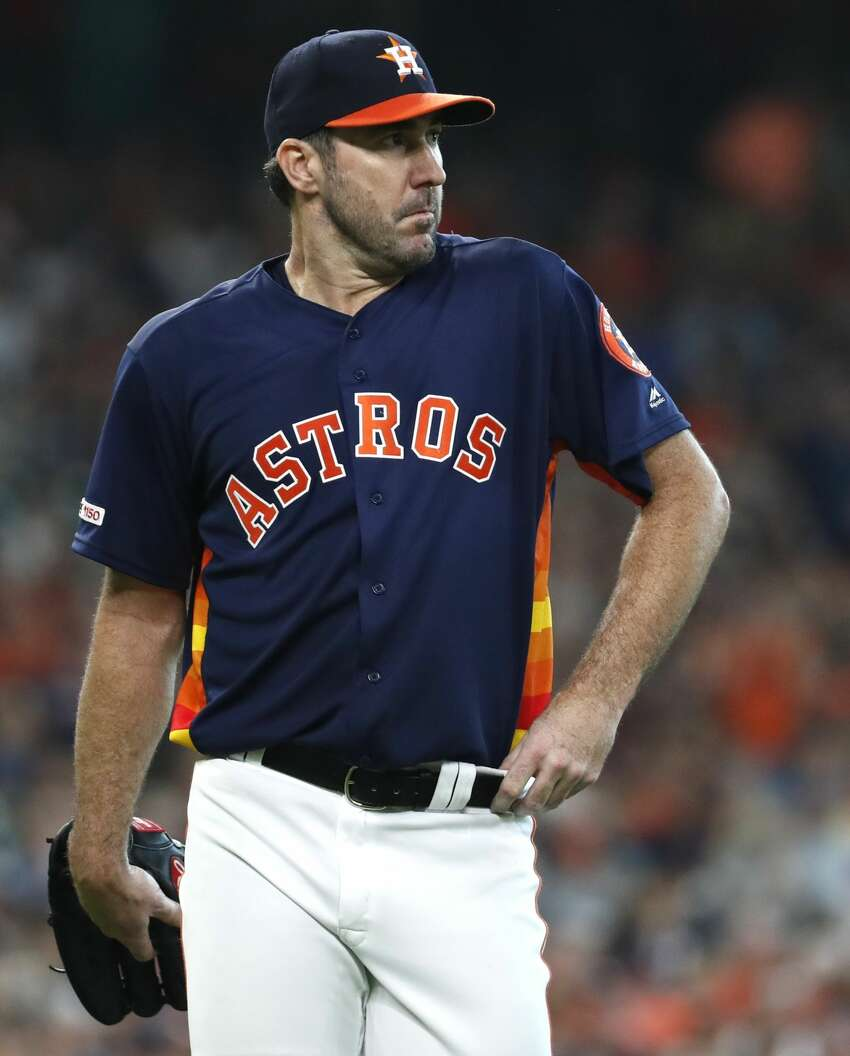 Houston Astros starting pitcher Justin Verlander walks off the field at the end of the seventh inning of a major league baseball game against the Boston Red Sox at Minute Maid Park on Sunday, May 26, 2019, in Houston.