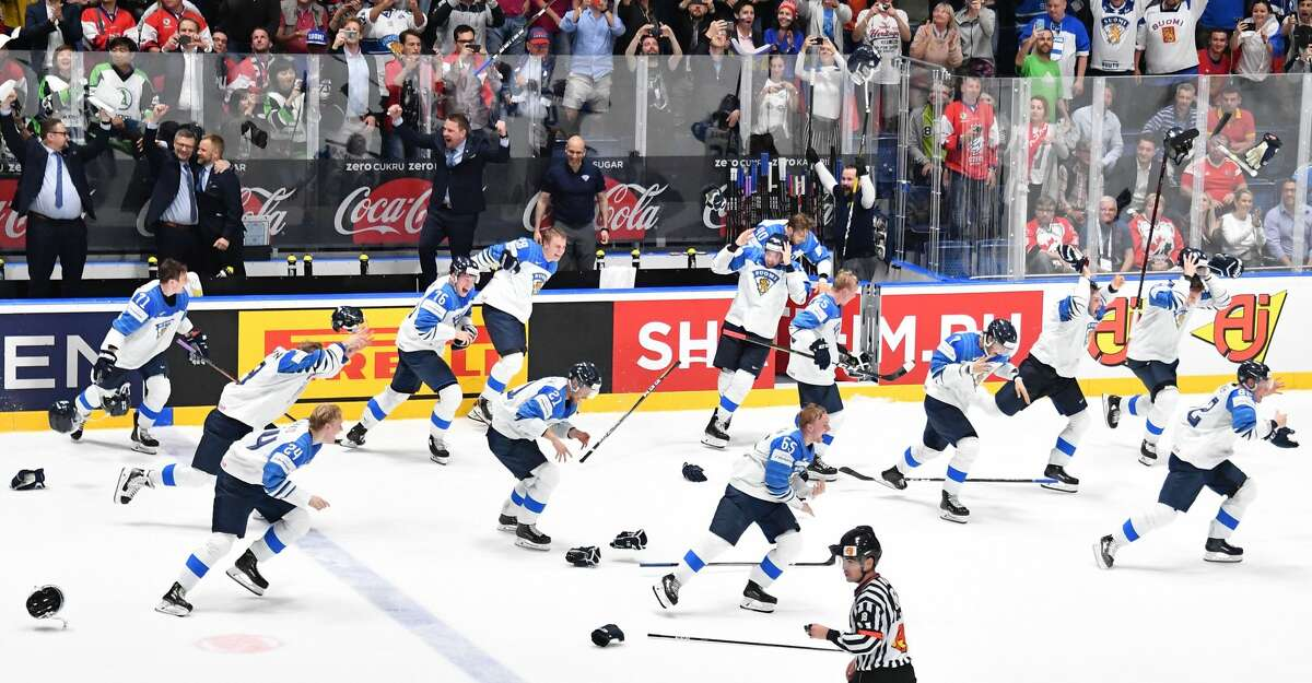 Finland's players celebrate as they win the gold medal match Canada vs Finland of the 2019 IIHF Ice Hockey World Championship at Steel Arena in Bratislava, Slovakia on May 26, 2019. (Photo by JOE KLAMAR / AFP)JOE KLAMAR/AFP/Getty Images