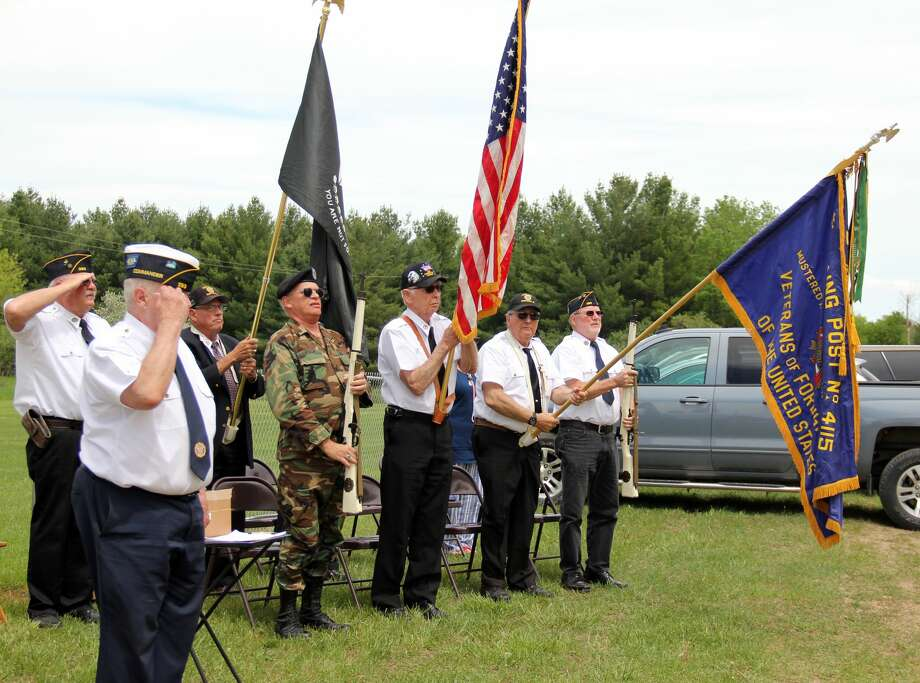 People gather to remember the service veterans and those who died in war combat during the 80th Annual Grant Memorial Day Service. Photo: Andrew Mullin/Huron Daily Tribune