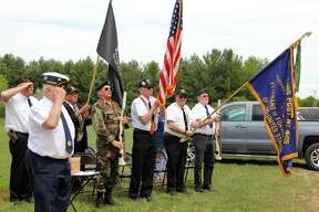 People gather to remember the service veterans and those who died in war combat during the 80th Annual Grant Memorial Day Service.