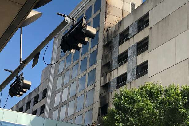 Houston firefighters responded to a blaze that erupted in a parking garage at Polk and Jackson next to the Hilton hotel on May 25, 2019.