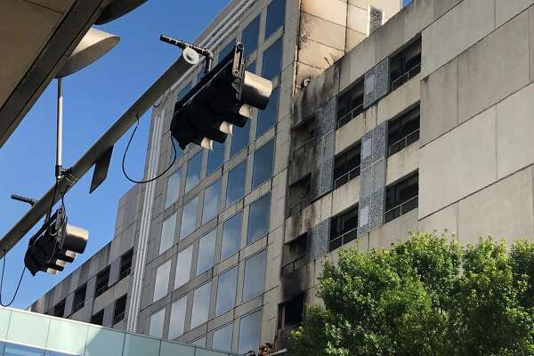 Car fire erupts in Hilton parking garage in downtown Houston