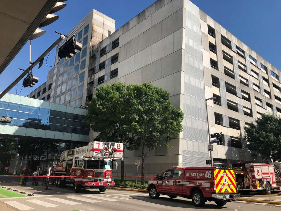 Houston firefighters responded to a blaze that erupted in a parking garage at Polk and Jackson next to the Hilton hotel on May 25, 2019. Photo: Julie Garcia