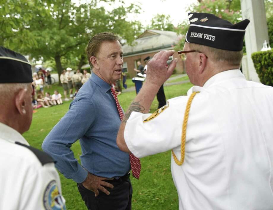 Gov. Ned Lamont chats with veterans at the annual Memorial Day Parade in Glenville Sunday Photo: Tyler Sizemore / Hearst Connecticut Media / Greenwich Time