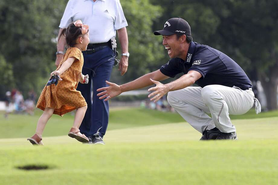 Sophia Na runs to her father, Kevin Na, after he won the Colonial golf tournament by four shots in Fort Worth, Texas. Photo: Richard W. Rodriguez / Associated Press