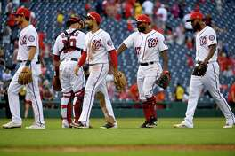 The Nationals celebrate their 9-6 win against the Marlins at Nationals Park in Washington on May 26, 2019, securing their third straight win, their longest winning streak this season.