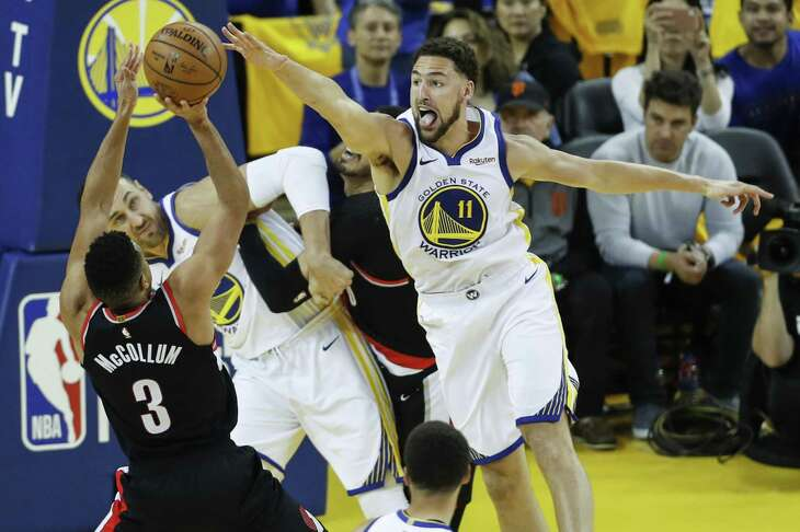 Golden State Warriors Klay Thompson defends against Portland Trail Blazers CJ McCollum in the third quarter during game 1 of the Western Conference Finals between the Golden State Warriors and the Portland Trail Blazers at Oracle Arena on Tuesday, May 14, 2019 in Oakland, Calif.