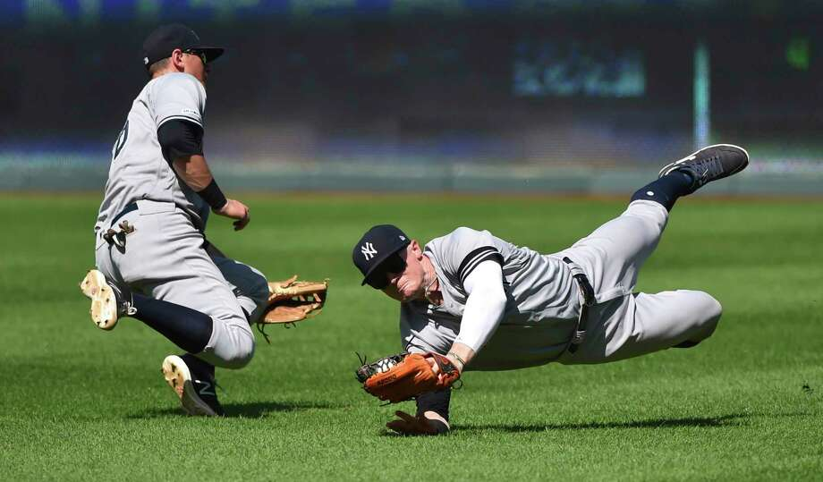 New York Yankees right fielder Clint Frazier, right, avoids a collision with second baseman DJ LeMahieu as he catches a ball hit by Kansas City Royals' Whit Merrifield in the ninth inning during a baseball game Sunday, May 26, 2019, in Kansas City, Mo. The Royals won 8-7 in 10 innings. (AP Photo/Ed Zurga) Photo: Ed Zurga / Copyright 2019 The Associated Press. All Rights Reserved.