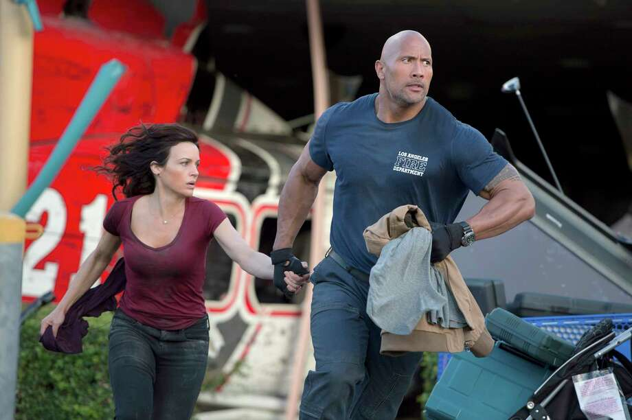 L-r) Carla Gugino as Emma and Dwayne Johnson as Ray try to cope with a massive earthquake in ?San Andreas.? Illustrates FILM-SANANDREAS-ADV29 (category e), by Michael O?Sullivan © 2015, The Washington Post. Moved Wednesday, May 27, 2015. (MUST CREDIT: Jasin Boland/Warner Bros. Entertainment.) Photo: HANDOUT / THE WASHINGTON POST