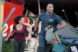 L-r) Carla Gugino as Emma and Dwayne Johnson as Ray try to cope with a massive earthquake in ?San Andreas.? Illustrates FILM-SANANDREAS-ADV29 (category e), by Michael O?Sullivan © 2015, The Washington Post. Moved Wednesday, May 27, 2015. (MUST CREDIT: Jasin Boland/Warner Bros. Entertainment.)