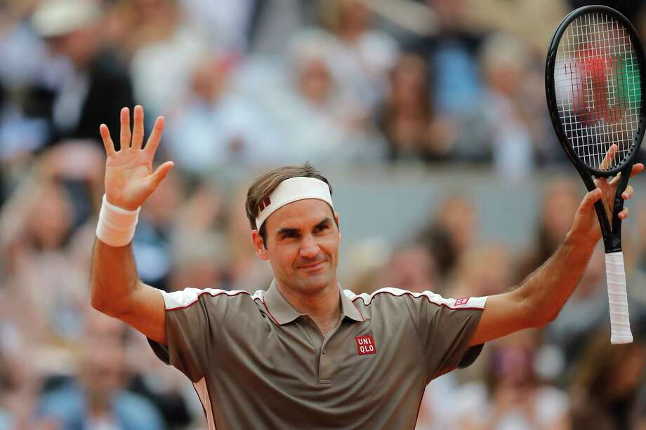Switzerland's Roger Federer celebrates winning against Italy's Lorenzo Sonego during their first round match of the French Open tennis tournament at the Roland Garros stadium in Paris, Sunday, May 26, 2019. (AP Photo/Michel Euler ) Photo: Michel Euler / Copyright 2019 The Associated Press. All rights reserved