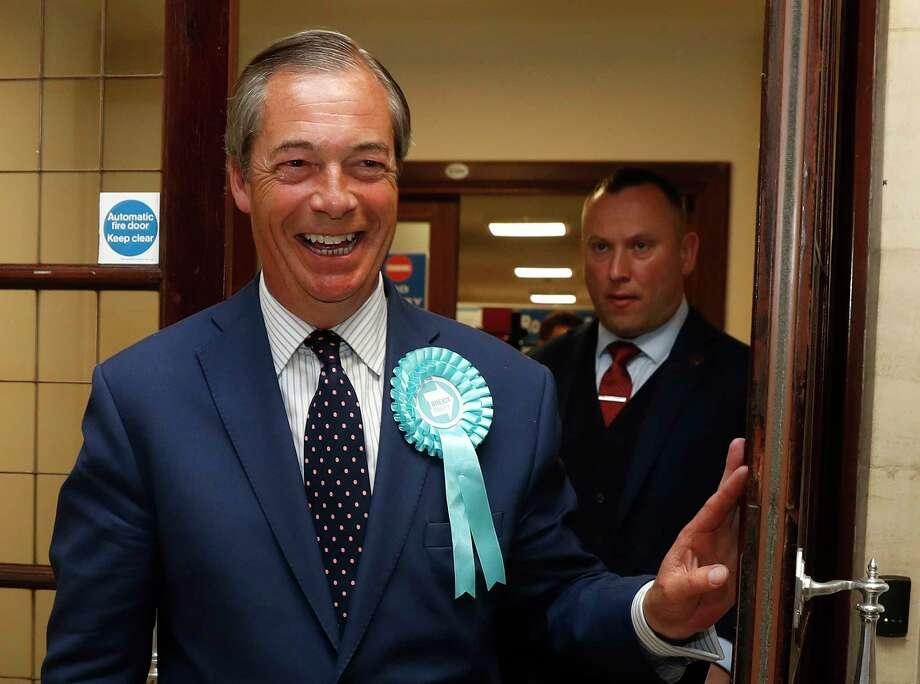 Brexit Party leader Nigel Farage smiles as he arrives at the counting center for the European Elections for the South East England region, in Southampton, England, Sunday, May 26, 2019. (AP Photo/Alastair Grant) Photo: Alastair Grant / Copyright 2019 The Associated Press. All rights reserved