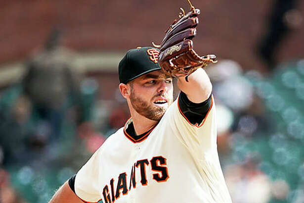 San Francisco Giants pitcher Sam Coonrod throws against the Arizona Diamondbacks during the eighth inning of his major-league debut Sunday in San Francisco. The 22-year-old from Carrollton, who was recalled from Triple-A Sacramento, pitched a scoreless inning while retiring the D-backs in order with one strikeout on 19 pitches for the Giants.