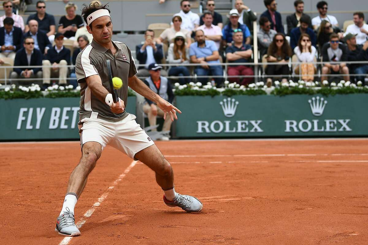 Switzerland's Roger Federer returns the ball to Italy's Lorenzo Sonego during their men's singles first round match on day 1 of The Roland Garros 2019 French Open tennis tournament in Paris on May 26, 2019. (Photo by Anne-Christine POUJOULAT / AFP)ANNE-CHRISTINE POUJOULAT/AFP/Getty Images