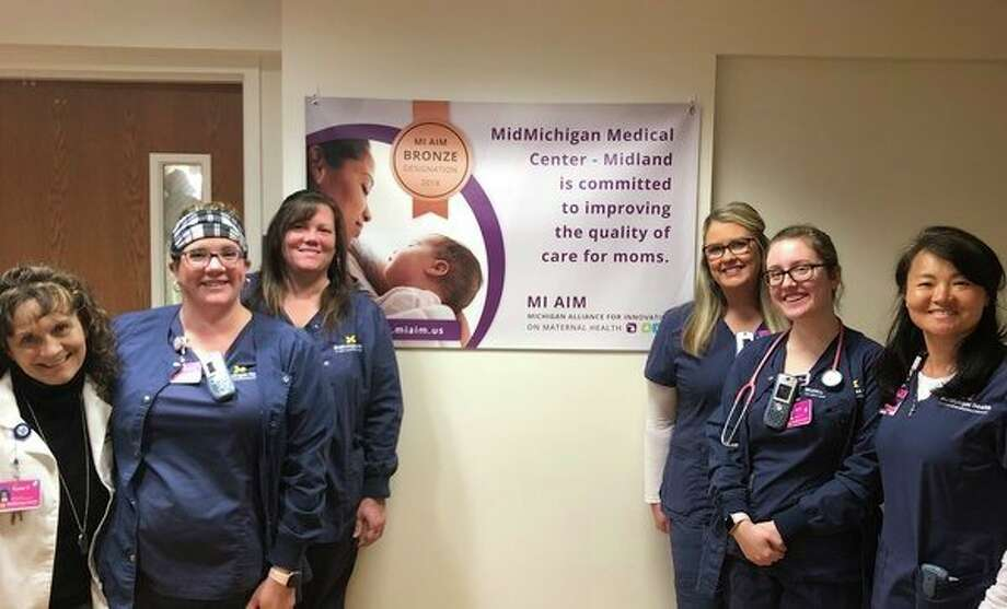 Staff from MidMichigan Medical Center - Midland's Maternity Center gather to celebrate their recent Bronze Designation by the Michigan Alliance for Innovation on Maternal Health. The Maternity Centers of MidMichigan Health Medical Centers in Alpena and Gratiot also received the Bronze Designation, as well. (Photo provided)