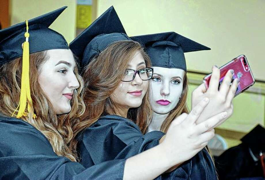 Three Beardstown High School classmates take a selfie before Sunday's graduation ceremony. Photo: David Blanchette | For The Journal-Courier