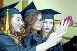 Three Beardstown High School classmates take a selfie before Sunday's graduation ceremony.