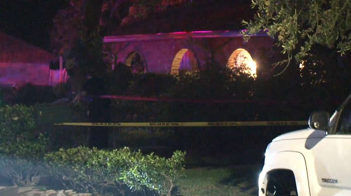 Houston police investigate the scene of a shooting early Monday, May 27, at a home in the 11300 block of Hendon in southwest Houston. Two men were found shot dead on a porch.