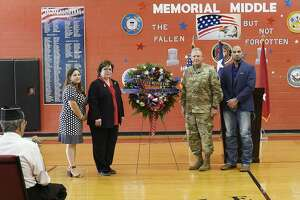 Memorial Middle School Principal Melissa Valdez, Laredo ISD Superintendent Sylvia Rios, Commanding General of the 36th Infantry Division, Major General Patrick Hamilton and Webb County Judge Tano Tijerina pose next to a memorial wreath at the LISD Memorial Day Observance at Memorial Middle School on Thursday.