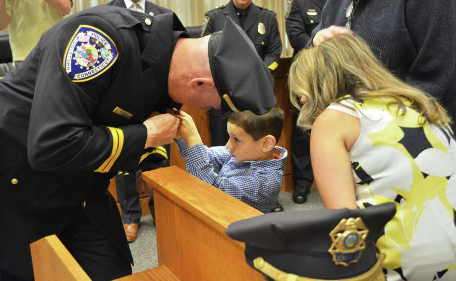 Newly installed Middletown police Capt. Richard Davis is pinned by his son May 24, 2019. Photo: Cassandra Day / Hearst Media Connecticut