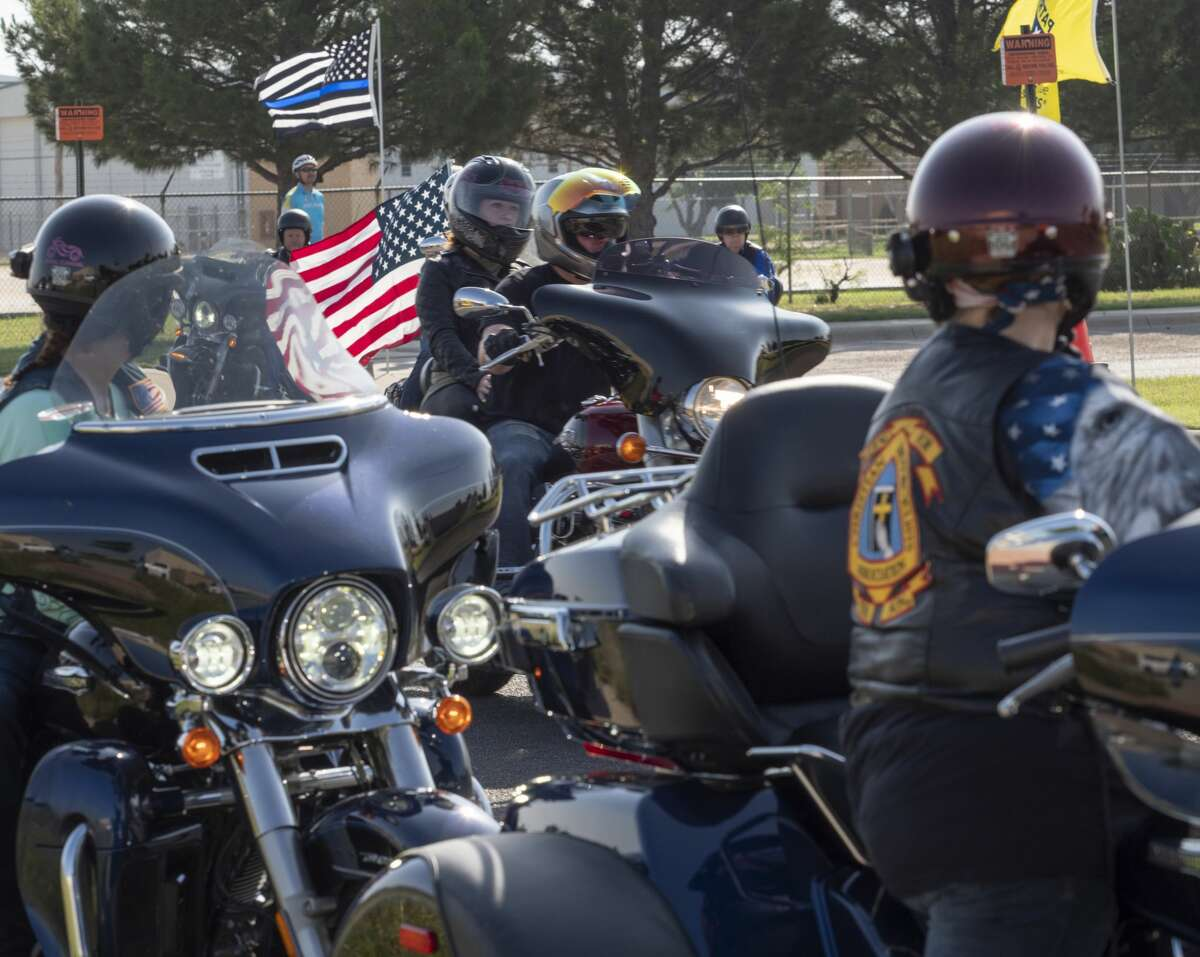 Riders make their way past the Vietnam Memorial 05/27/19 during the Memorial Day Ride to Remember as they parade through Midland on the way to a Memorial Day service in Andrews. Tim Fischer/Reporter-Telegram