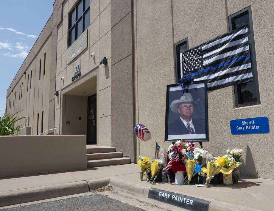 A memorial has been set up outside the Midland Sheriff's Department at the parking spot reserved for Sheriff Gary Painter. 05/27/19 Tim Fischer/Reporter-Telegram Photo: Tim Fischer/Midland Reporter-Telegram