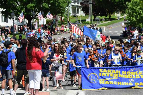 Spectrum/New Milford recognized Memorial Day with a ceremony in front of the New Milford Public Library, followed by a parade downtown. May 27, 2019. Above, the Sarah Noble Intermediate School band is welcomed by cheering parade-goers.