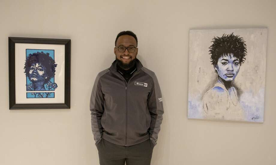 Nick Bascus with his art at his solo exhibit in the 2019 Juried Art Exhibition.  Jacy Lewis/191 News Photo: Jacy Lewis/191 News