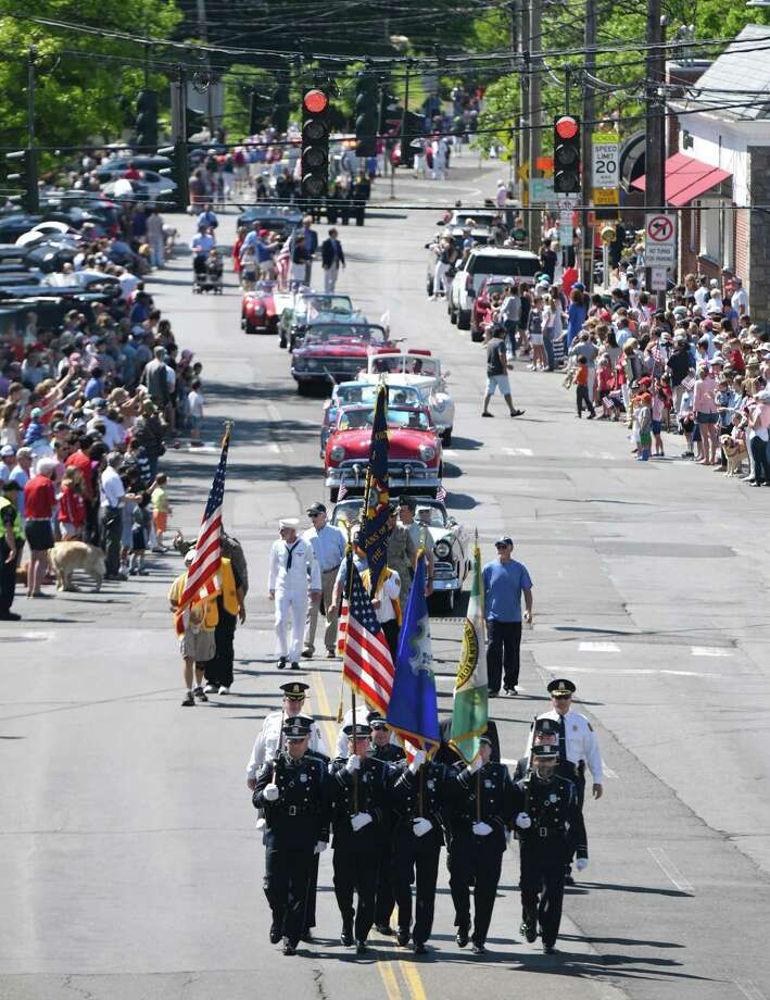 The Sound Beach Volunteer Fire Department leads the way down Sound Beach Avenue for the 2019 Old Greenwich Memorial Day Parade in Old Greenwich, Conn. Monday, May 27, 2019. Several local groups and businesses marched in the parade alongside firefighters, police officers and EMS. The parade concluded with a ceremony of remembrance at Binney Park. Photo: Tyler Sizemore / Hearst Connecticut Media / Greenwich Time