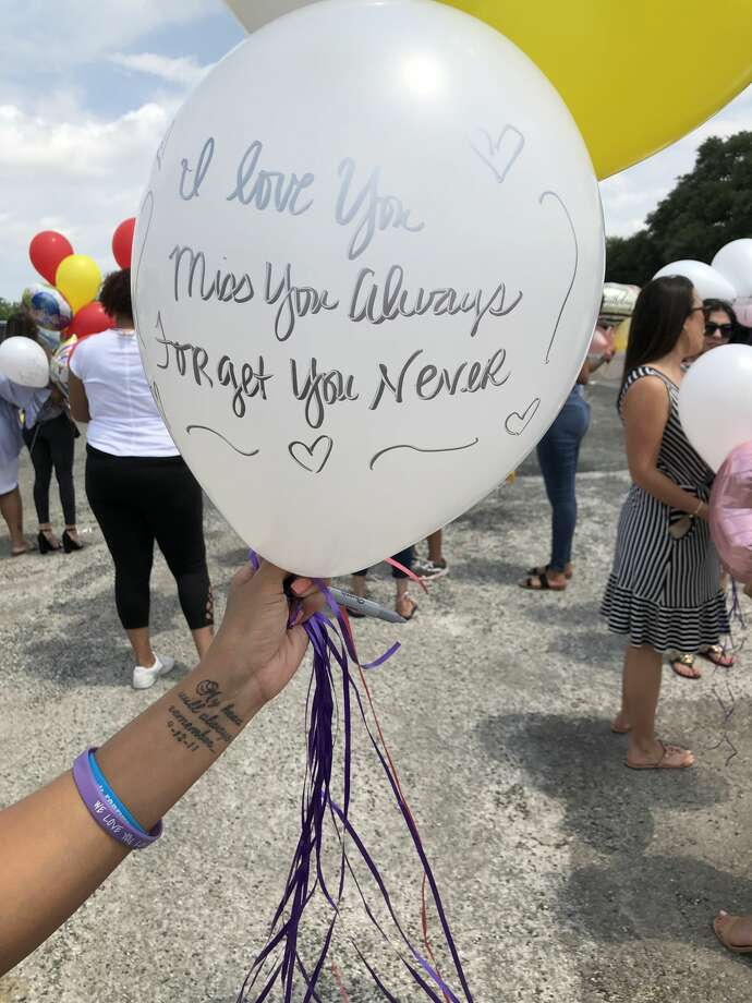 Friends and family of Nichol Olsen gathered at Raymond Russell Park today to release balloons in celebration of what would have been her 38th birthday. Olsen was shot to death almost five months ago with her two daughters, Alexa Denice Montez, 16, and London Sophia Bribiescas, 10, at a luxury home near Leon Springs. Photo: Peggy O'Hare