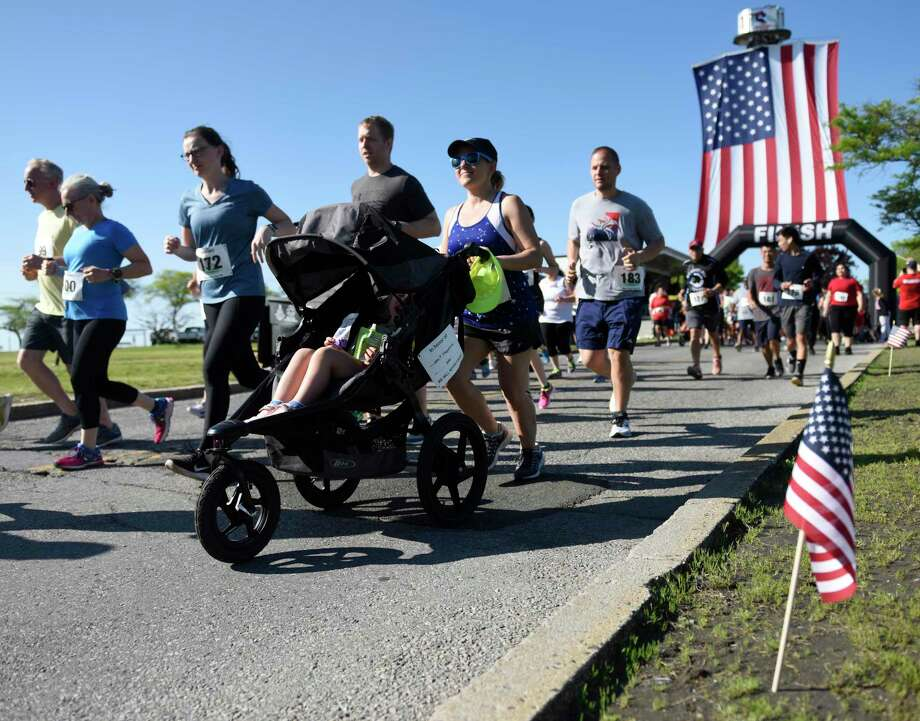 Photos from the first Memorial Day 5K run at Cummings Point Park in Stamford, Conn. Monday, May 27, 2019. Due to diminishing crowds and ongoing renovation of Veterans Memorial Park, Stamford held a 5K run and Memorial Day ceremony instead of the usual parade through downtown. About 300 runners participated in the 5K, which preceeded a service on the beach in honor of the fallen veterans. Photo: Tyler Sizemore / Hearst Connecticut Media / Greenwich Time