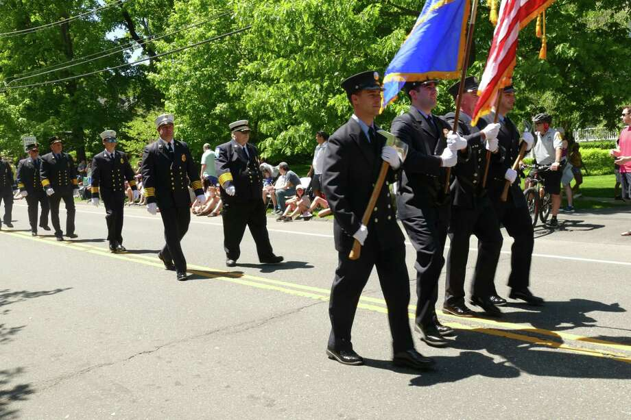 Members of the Ridgefield Volunteer Fire Department marched in the town's annual Memorial Day parade Monday, May 27, 2019. Photo: Stephen Coulter / Hearst Connecticut Media