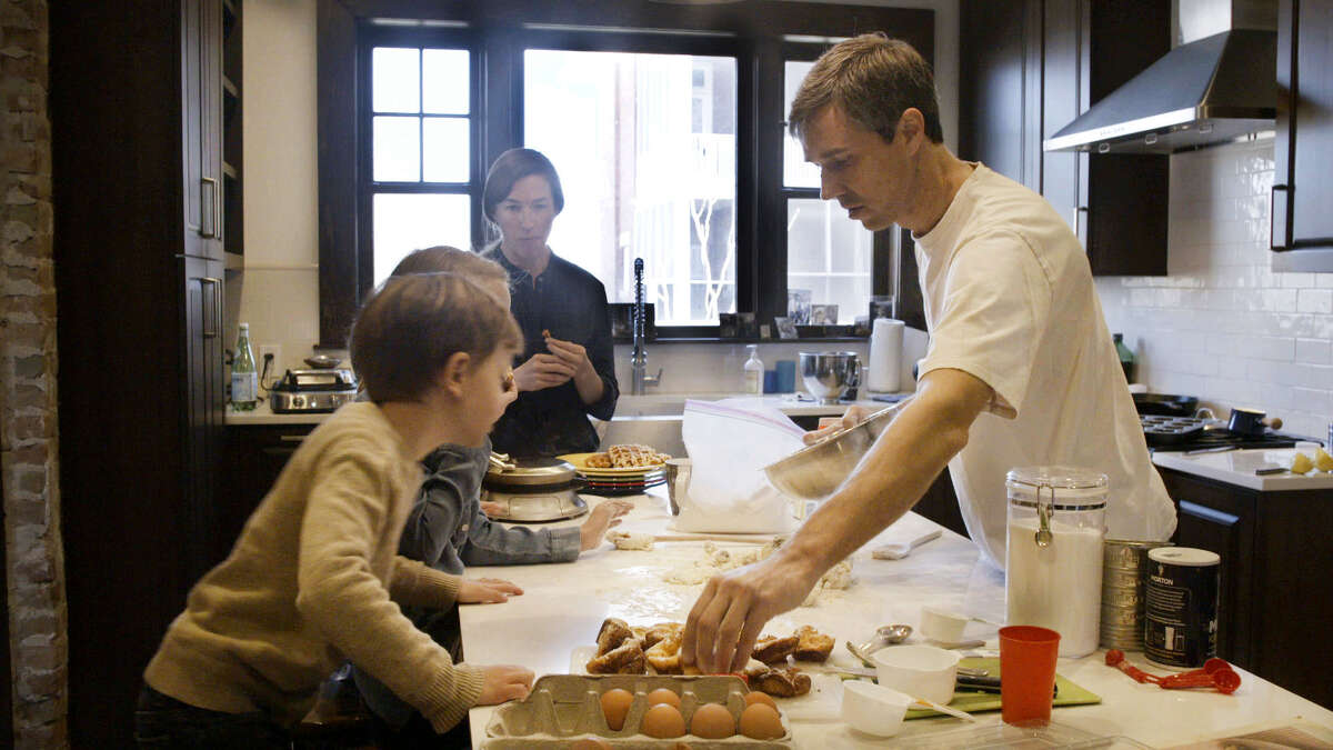 Beto O'Rourke, right, cooks for his children alongside his wife, Amy, in the kitchen.