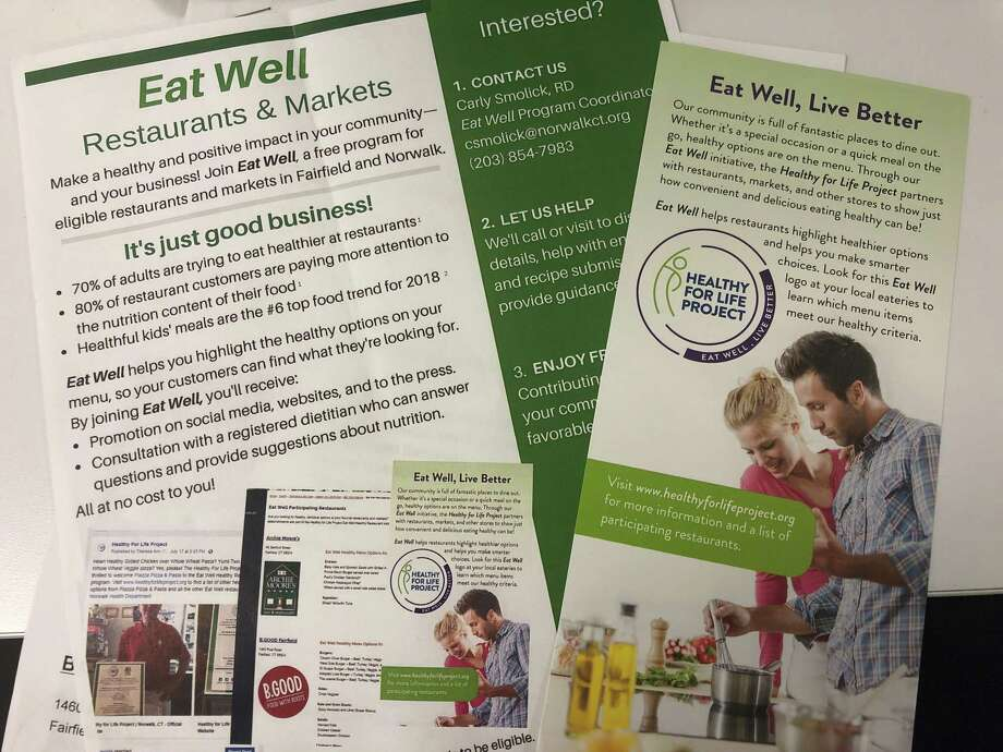 "The ""Eat Well"" Intiative from the Norwalk and Fairfield Health Departments aims to encourage customers to pick healthy options while dining out. Photo: Kelly Kultys / Hearst Connecticut Media"