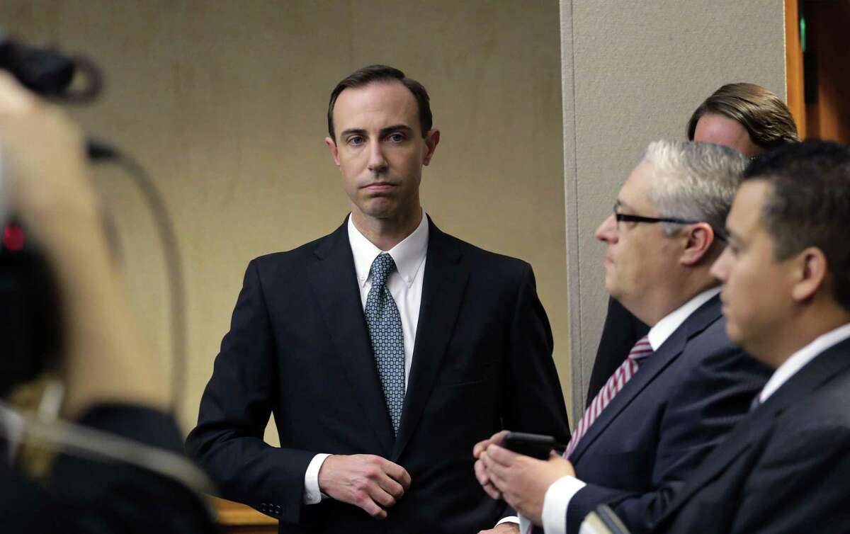 """FILE - In this Feb. 7, 2019 file photo, Secretary of State David Whitley, left, arrives for his confirmation hearing in Austin, Texas. Texas has settled a federal lawsuit over the state's bungled search for non-citizens among the state's 16 million registered voters. The agreement announced Friday, April 26, 2019 ends an effort by Texas elections officials that led to the state wrongly questioning the U.S. citizenship of tens of thousands of voters. Whitley said the agreement allows the state to continue """"voter registration list maintenance"""" but ensures that the same mistakes won't happen again. (AP Photo/Eric Gay, File)"""