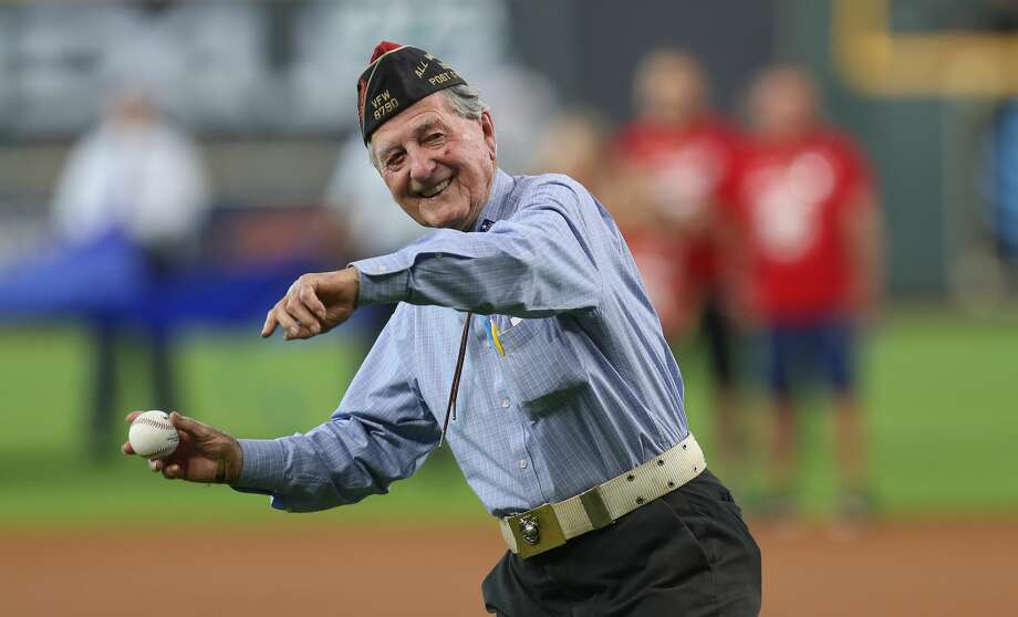 WWII Marine Bob Cook throws out the 1st pitch before a MLB baseball game at Minute Maid Park Monday, May 27, 2019, in Houston. Photo: Steve Gonzales/Staff Photographer