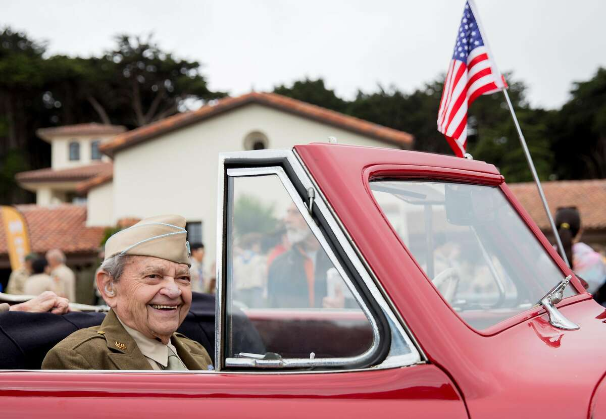 World War II veteran Bill Beckman rides in a vintage car through the Presidio during the annual Memorial Day observance held at the Presidio Cemetery in San Francisco, Calif. Monday, May 27, 2019.