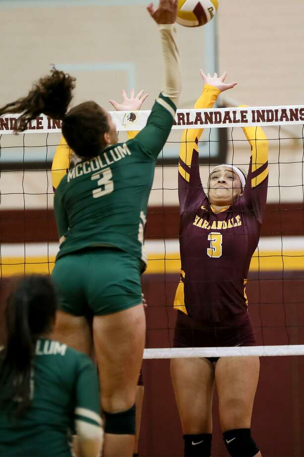 Harlandale's Mitsue Rodriguez (right) tries to block a shot by McCollum's Bryanna Rich during the finals of the 2018 Harlandale ISD Invitational Volleyball Tournament on Aug. 11, 2018. Rodriguez led Harlandale's team in kills the last two seasons. Photo: Marvin Pfeiffer /Staff Photographer / Express-News 2018