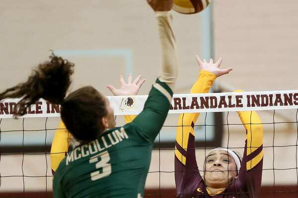 Harlandale's Mitsue Rodriguez (right) tries to block a shot by McCollum's Bryanna Rich during the finals of the 2018 Harlandale ISD Invitational Volleyball Tournament on Aug. 11, 2018. Rodriguez led Harlandale's team in kills the last two seasons.