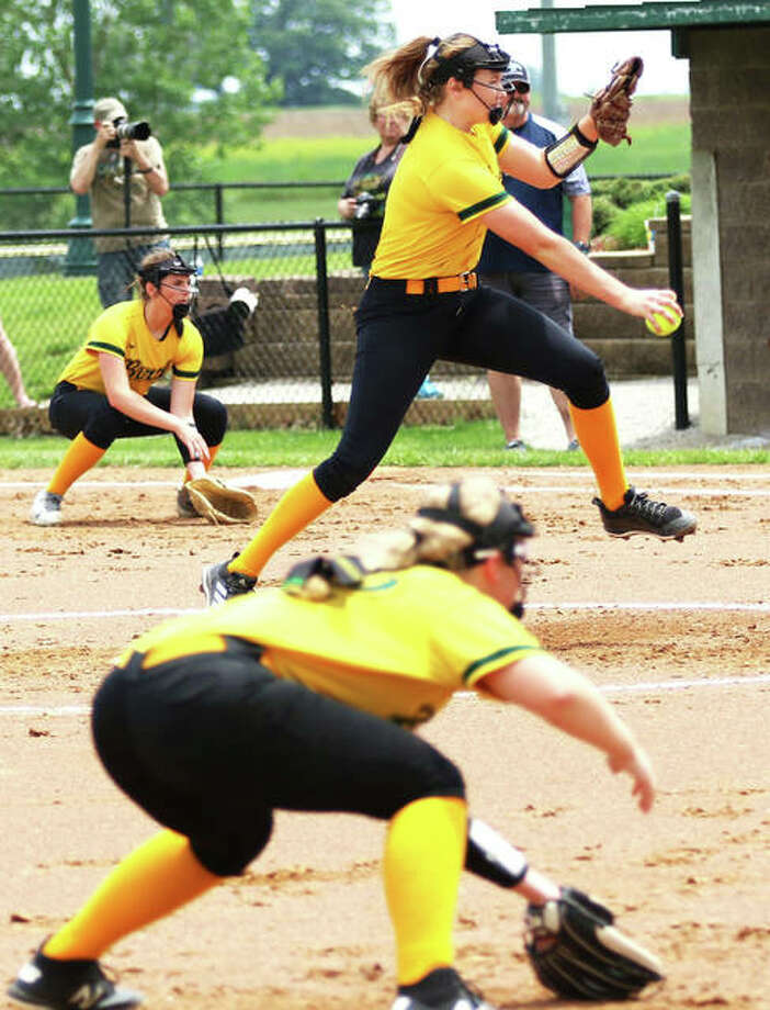 Southwestern pitcher Bailee Nixon (middle) fires to the plate while first baseman Sydney Baumgartner (left) and third baseman Bri Roloff look in the Olympia hitter Saturday in the Athens Class 2A Sectional. Photo: Greg Shashack / The Telegraph