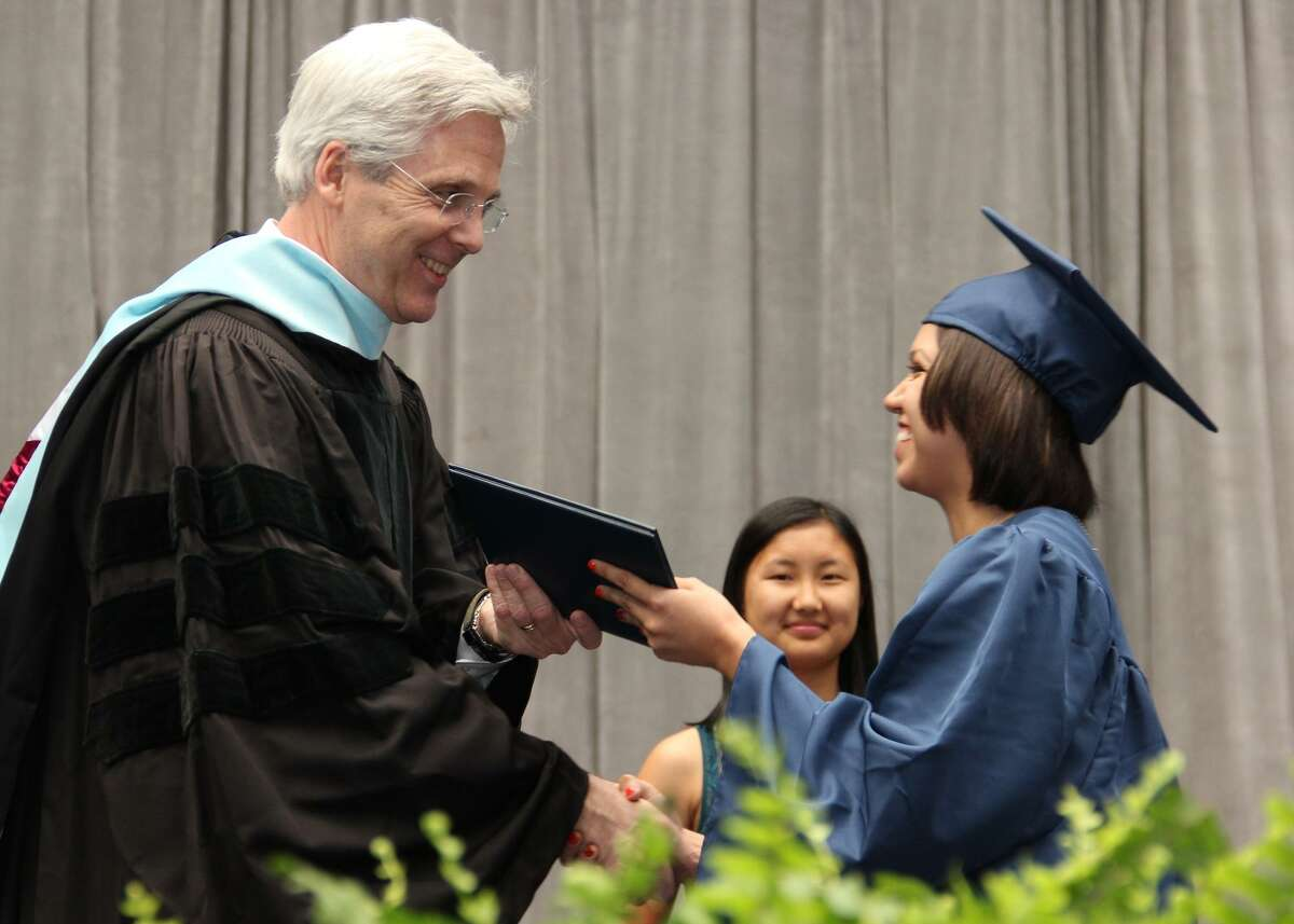 Pearland ISD Superintendent Dr. John Kelly presents a diploma in 2017.
